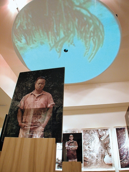 Standing Glass Portraits Dinh & Tommy G on wood stands with steel with Trees at Sea ceiling video LewEllen Contemporary Gallery